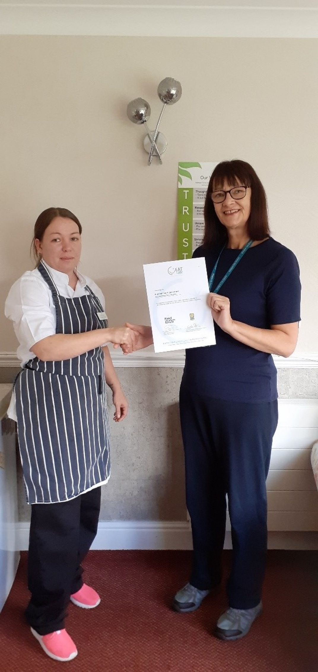 Head Chef Jacqueline (left) receiving the award.