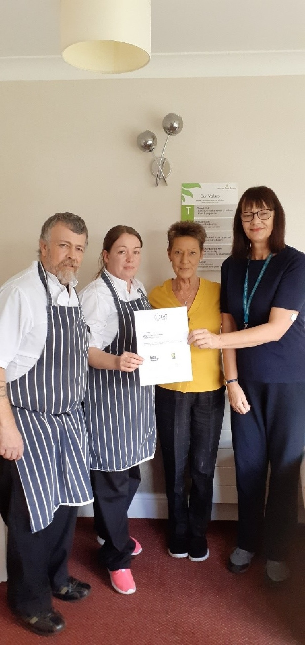Almond Court staff presented with their award.