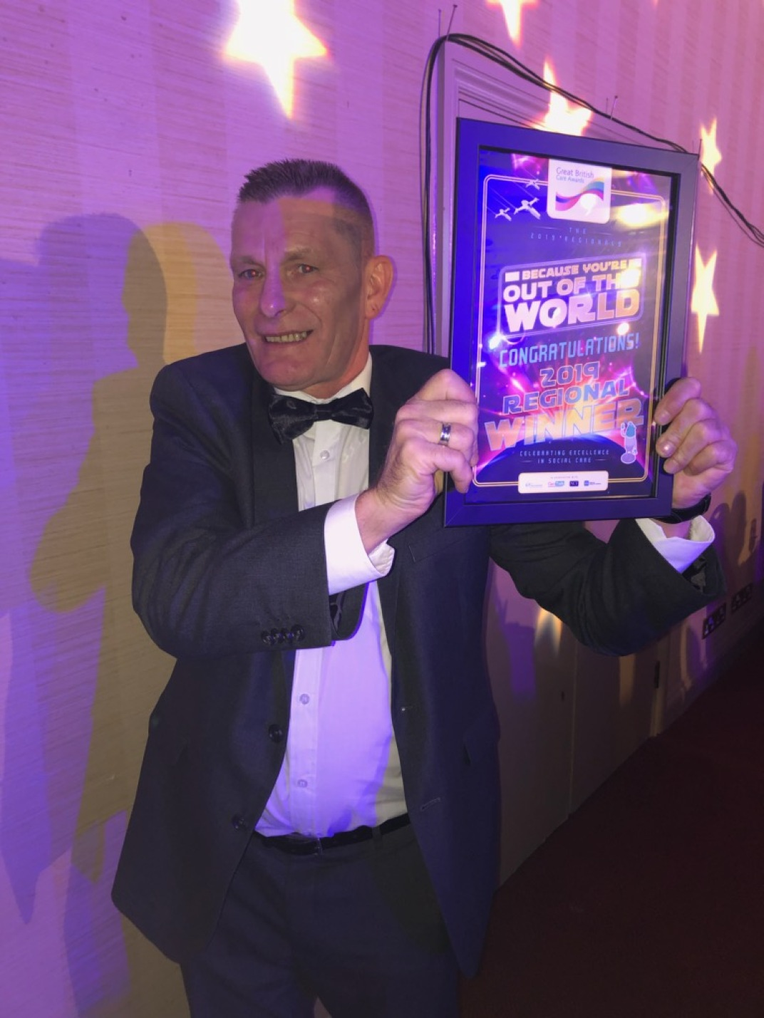 Billy celebrating with his award